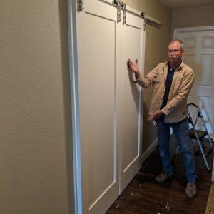frank, handyman at honest lee handyman in sacramento, installs sliding barn doors in home