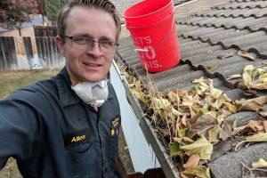 honest lee handyman performing gutter cleaning in sacramento
